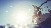 istock Man jumping and diving from a yacht sailboat 600166058