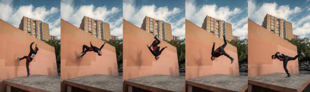 mann, springen und backflips beim üben von parkour in der stadt zu tun - parkour stock-fotos und bilder