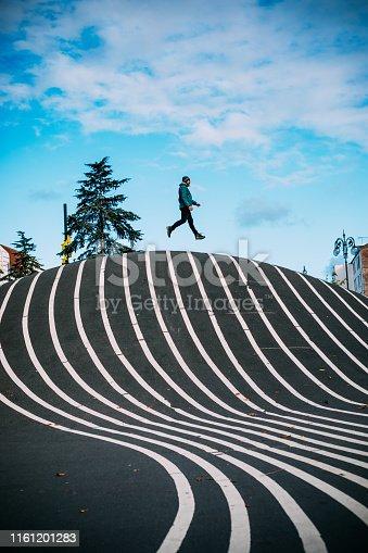 Man jumping at Superkilen Park in Copenhagen