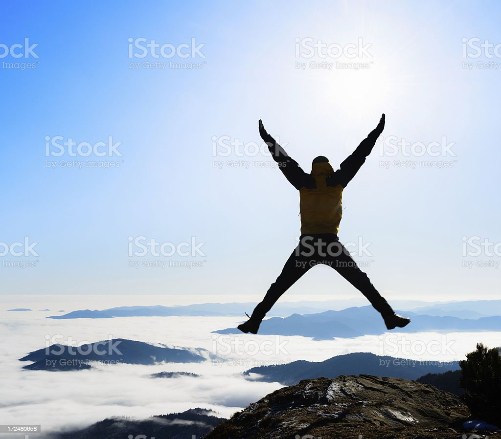 man jumping high in the mountains royalty-free stock photo