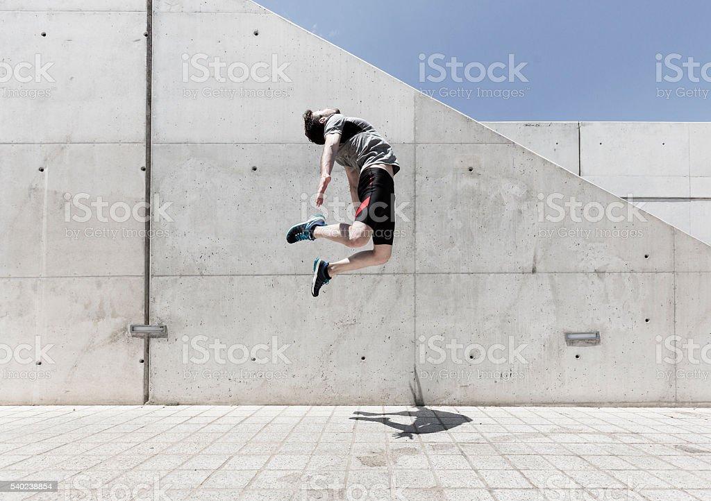 Man jumping high stock photo