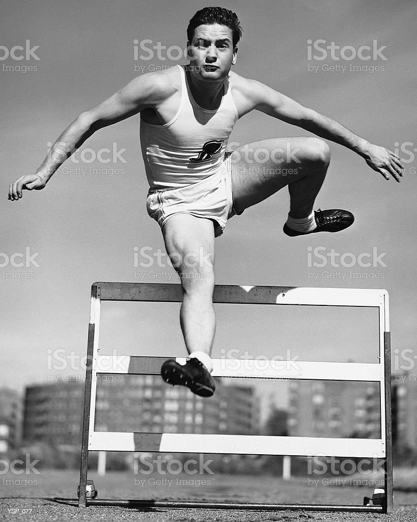 Man jumping hurdle royalty-free stock photo