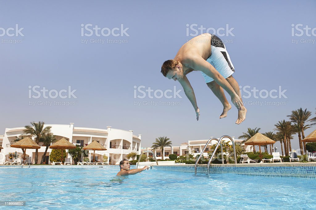 Man jumping in swimming pool royalty-free stock photo