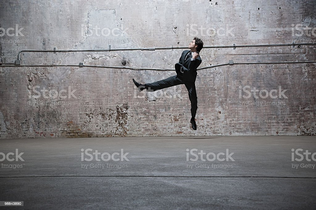 Man jumping in warehouse royalty-free 스톡 사진