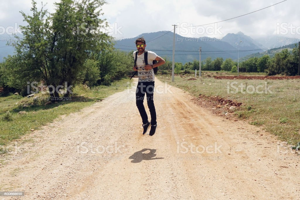 man jumping into the air stock photo