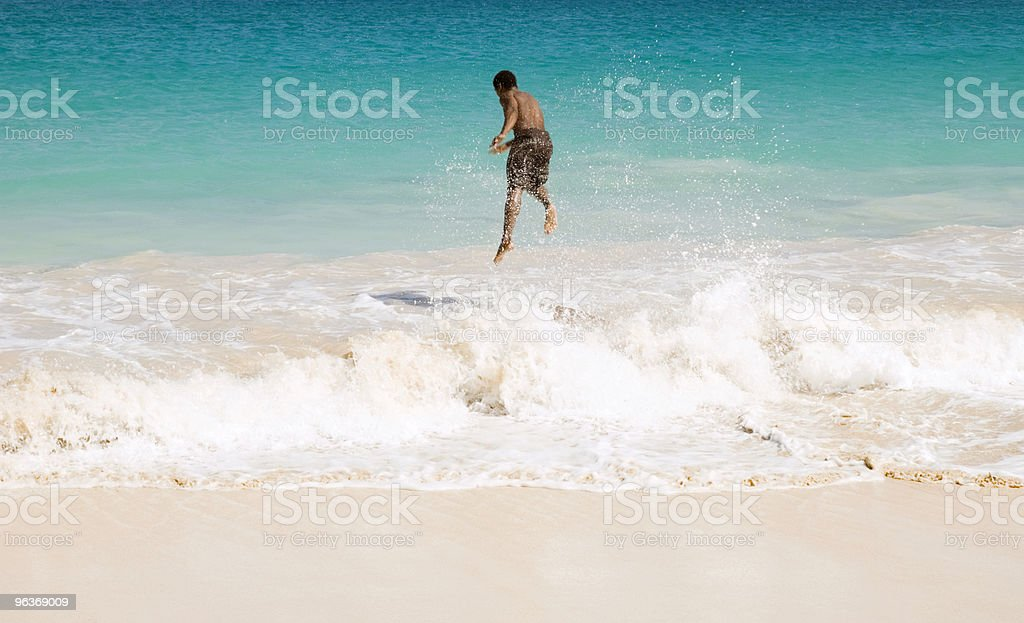 Man jumping into water stock photo