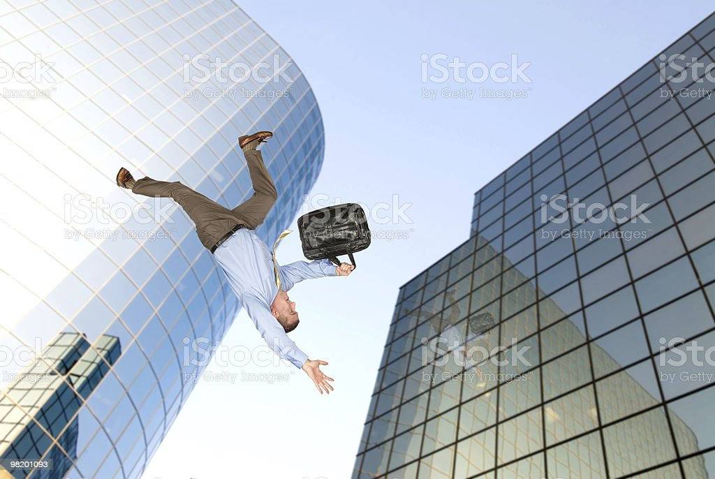 Man jumping off building royalty-free stock photo