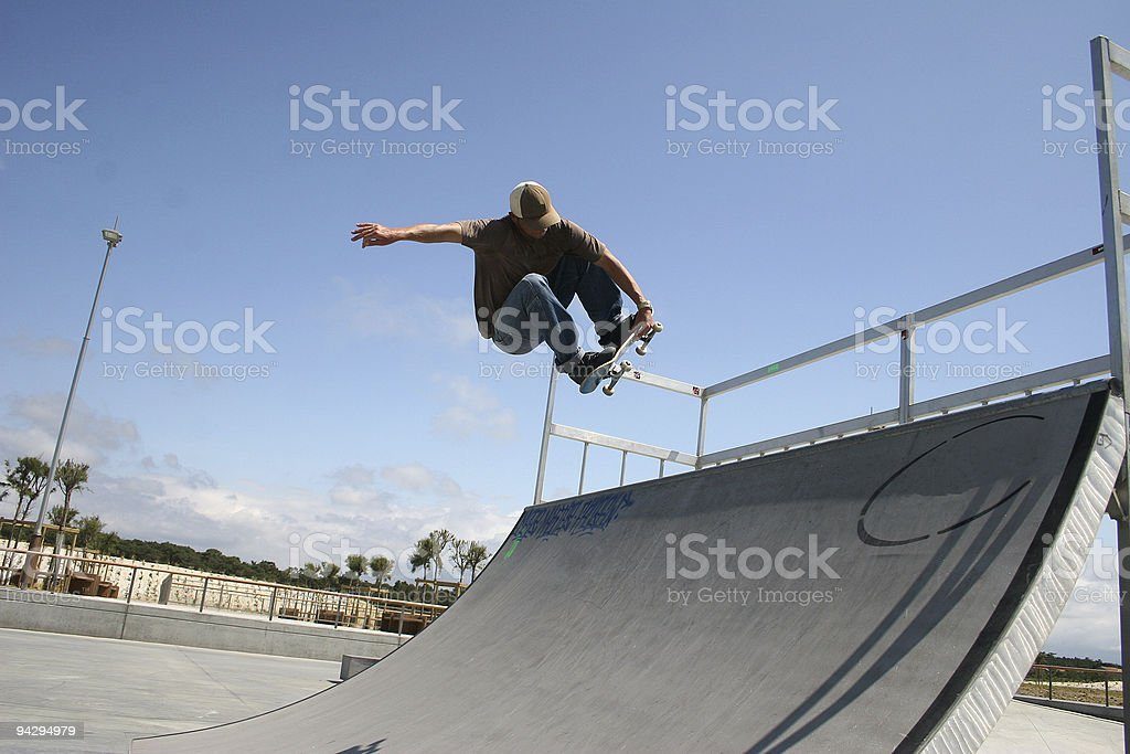 A man jumping on a skateboard  stock photo