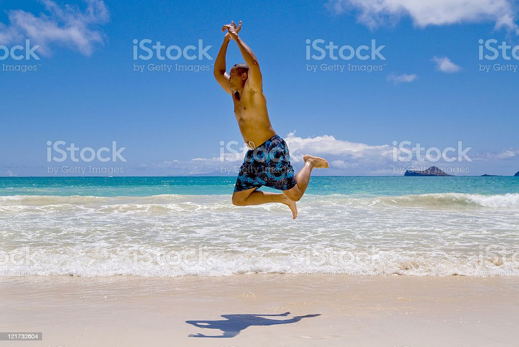 Man Jumping on the Beach royalty-free stock photo
