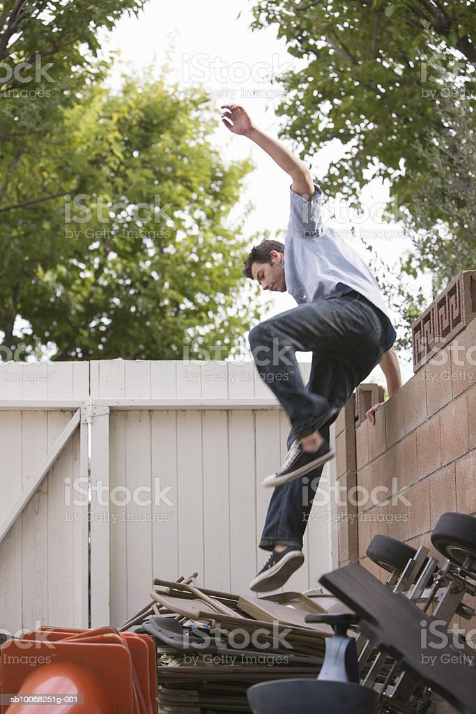 Man jumping over fence royalty-free stock photo