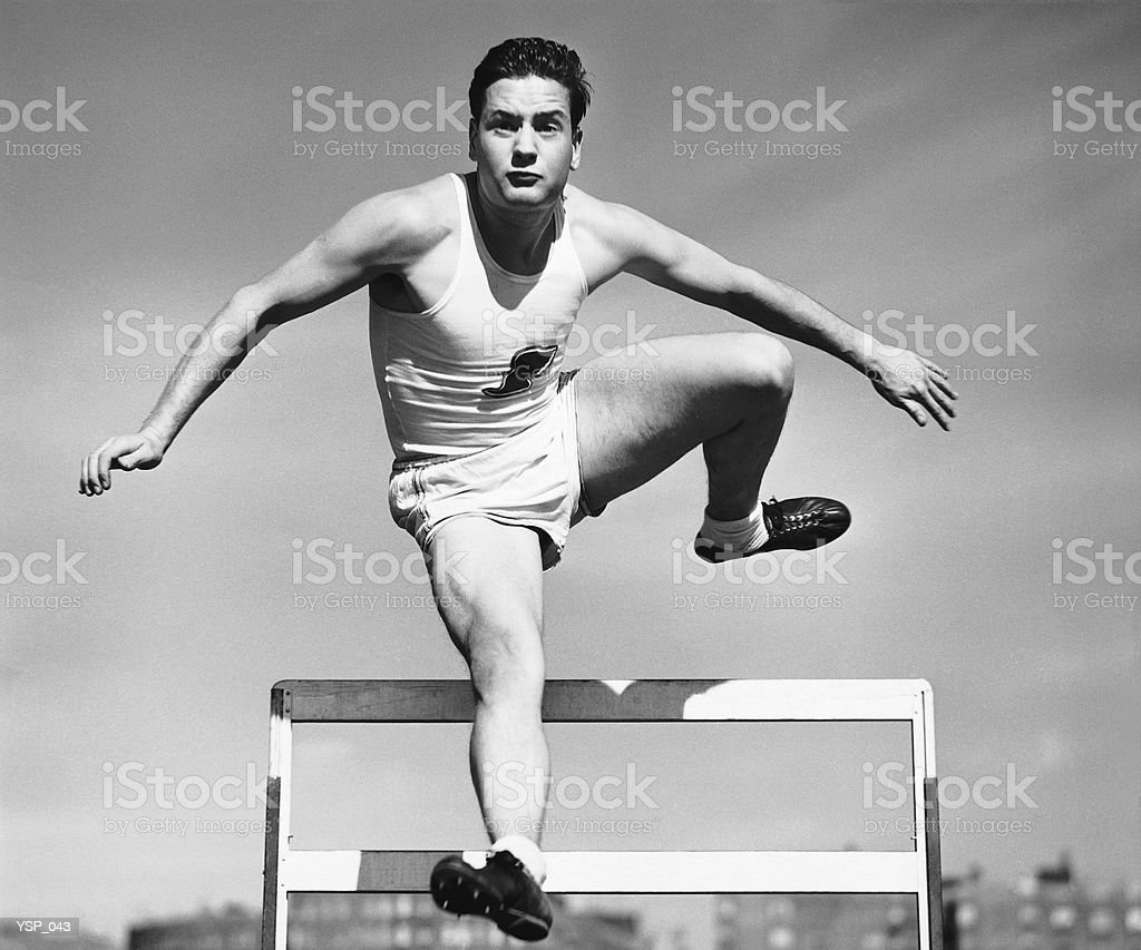 Man jumping over hurdle royalty-free stock photo