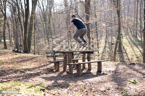 485902386 istock photo Man jumping over the bench 947316526
