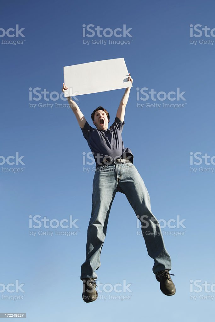 Man Jumping with Sign royalty-free stock photo