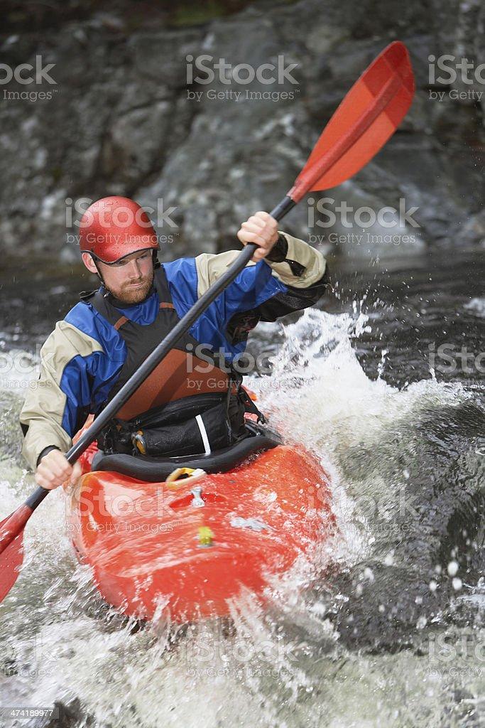 Man kayaking in river stock photo