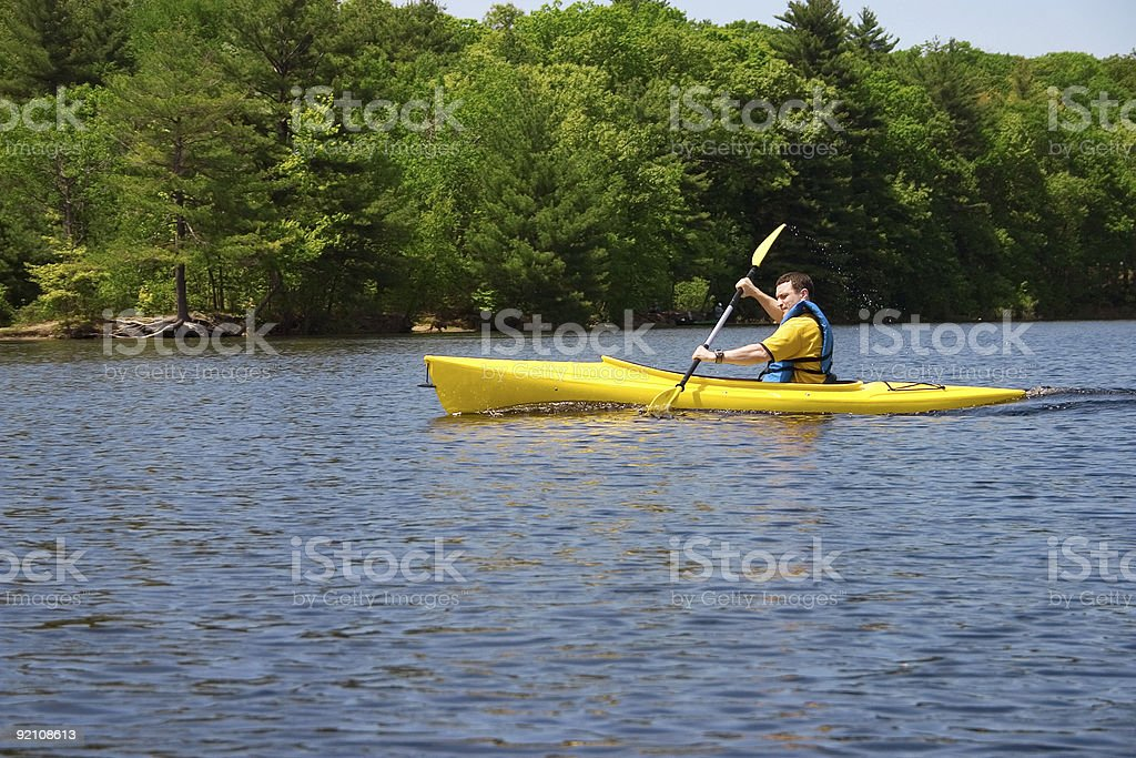 Man kayaking royalty-free stock photo