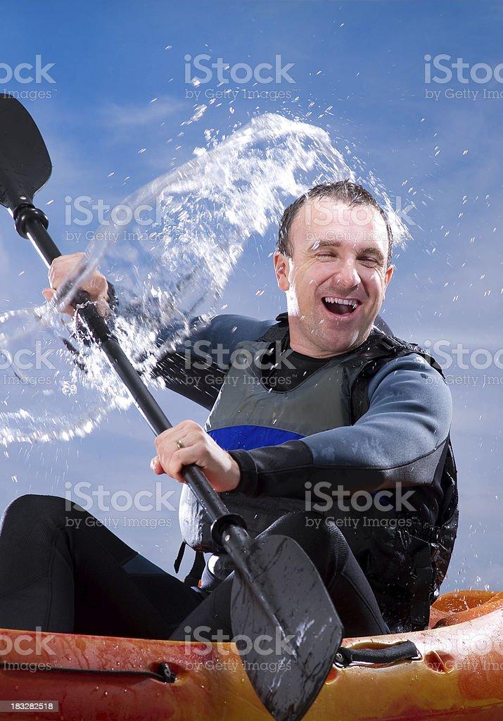 Man Kayaking Through Rough Waters royalty-free stock photo