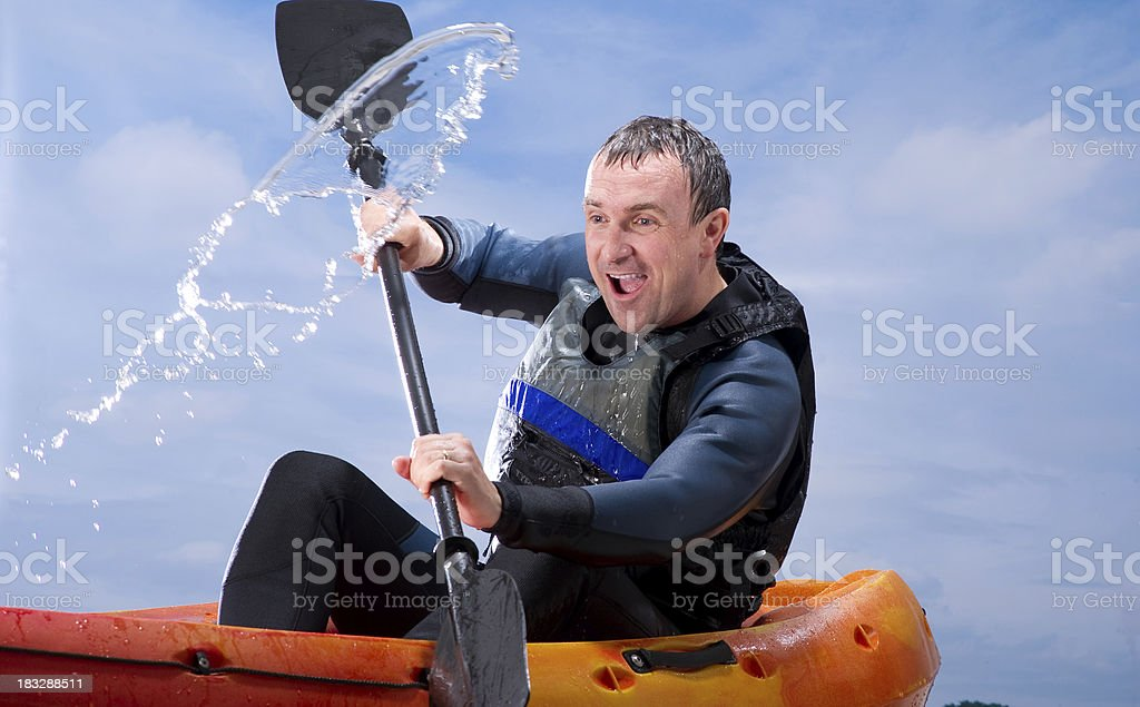 Man Kayaking Through Rough Waters royalty-free stock photo