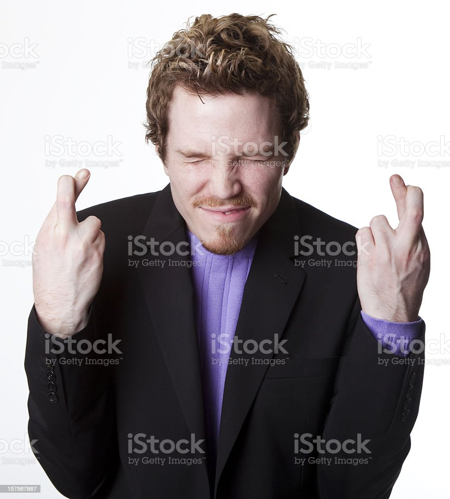 man keeping his fingers crossed royalty-free stock photo