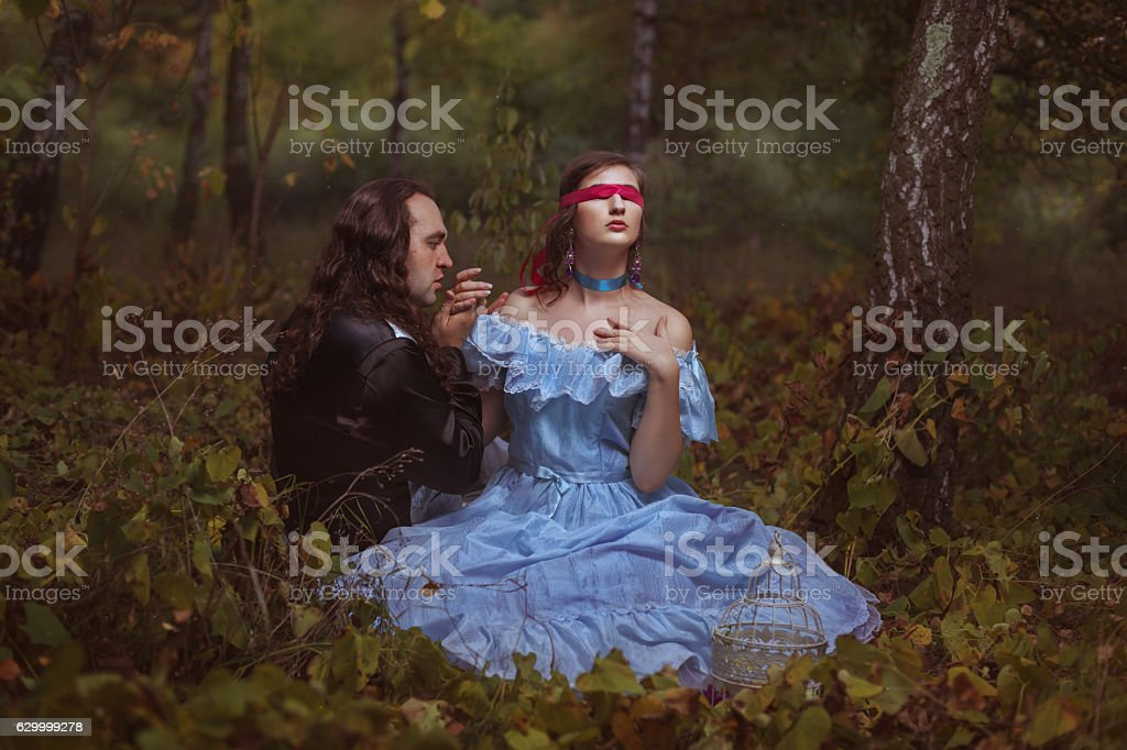 Man kisses a hand to the girl. stock photo