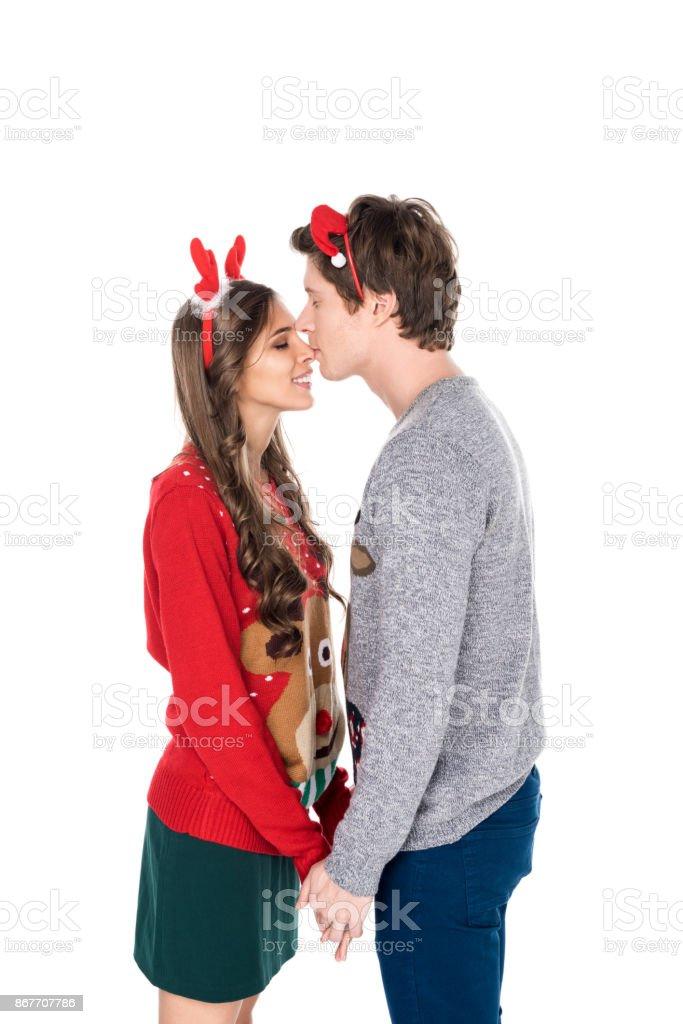 man kissing girlfriend stock photo