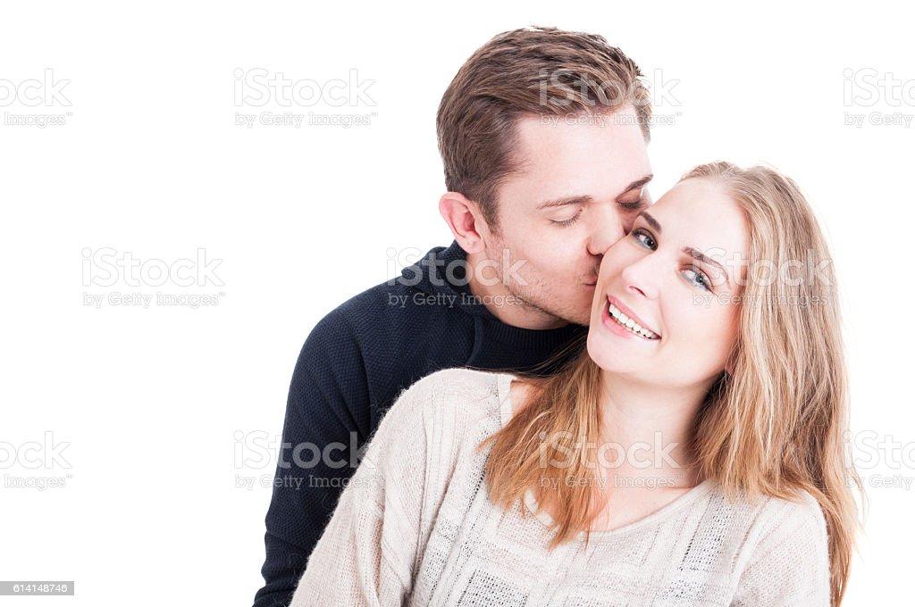 Man kissing on cheek her beautiful lady stock photo