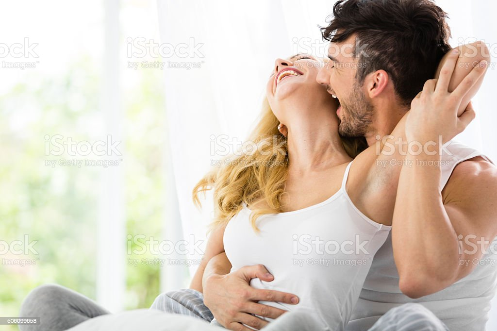 Man Kissing Woman In Bed Royalty Free Stock Photo