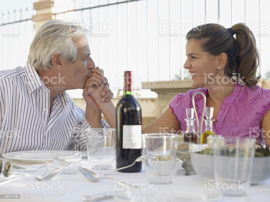 Man kissing woman's hand stock photo