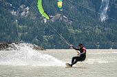 Kiteboarding in Squamish, British Columbia. Active male enjoying water sports. Adventure on the sea.