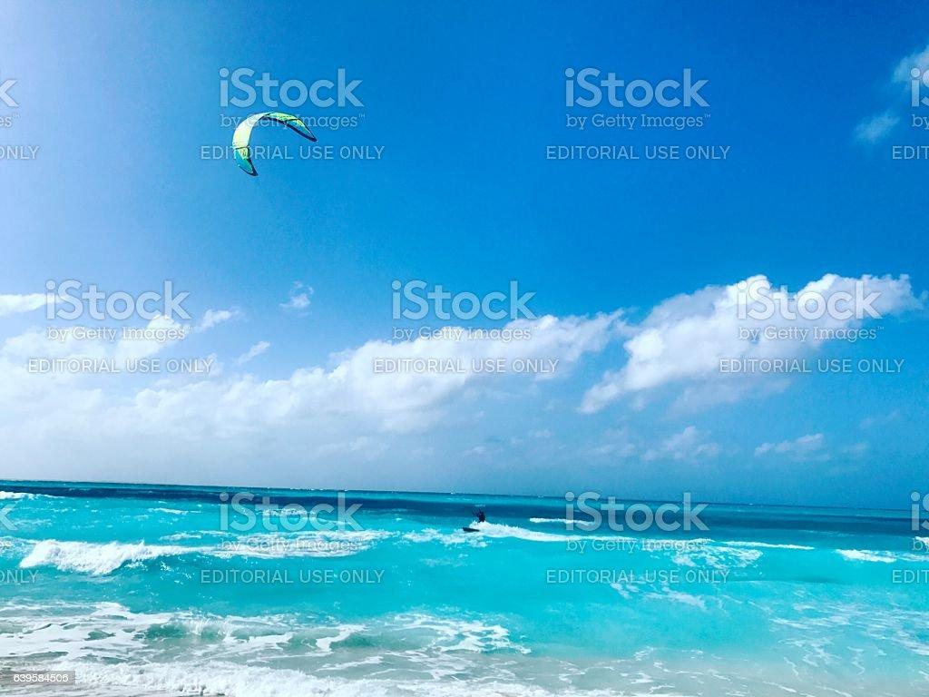 Man kitesurfing on Grace Bay Beach. Turks and Caicos Islands stock photo