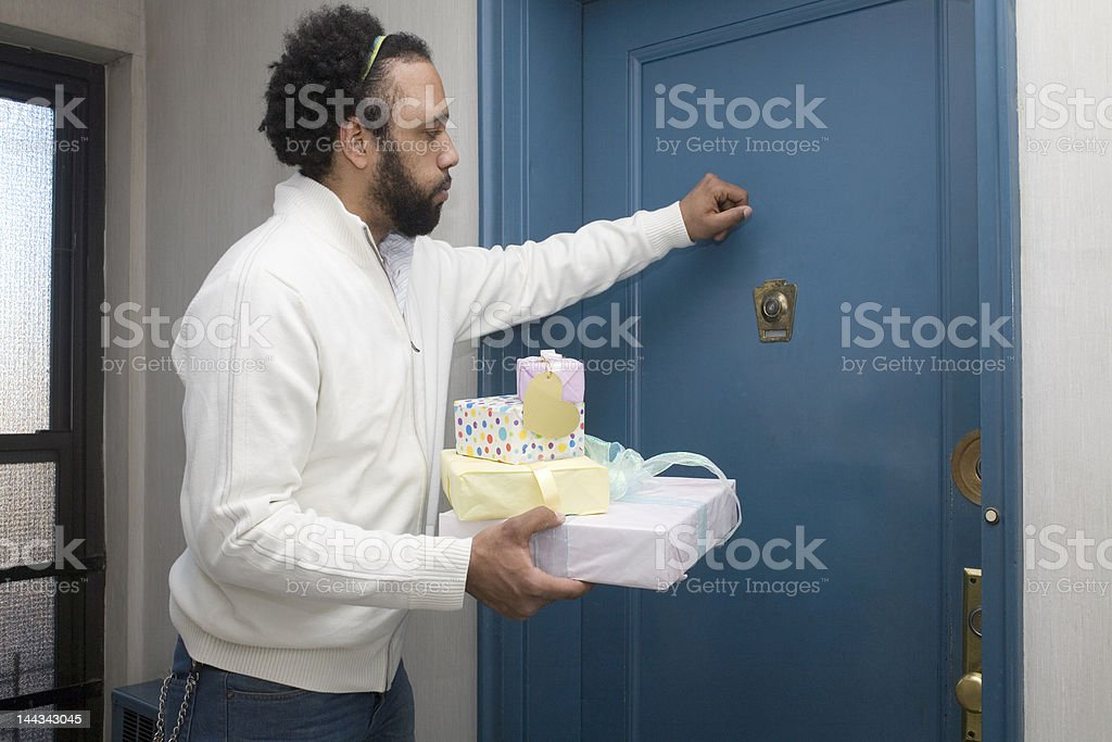 Man Knocking on the Door stock photo