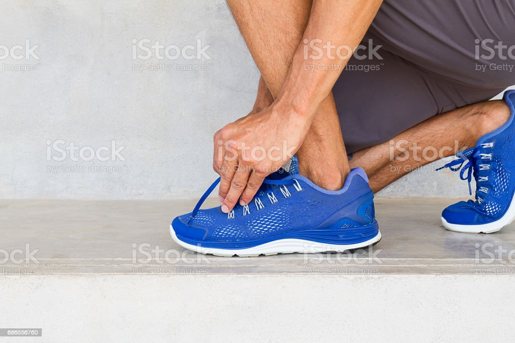 Man lacing sport shoes in gym, sport exercise concept royalty-free stock photo