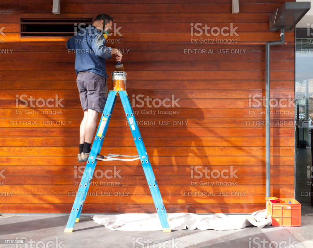Man lacquering wood stock photo