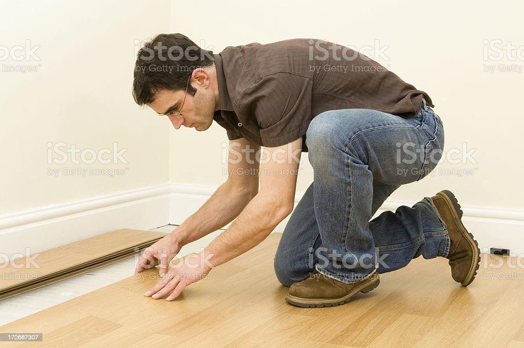 Man laying laminate flooring royalty-free stock photo