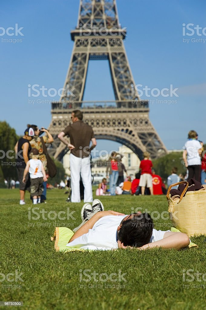 Man laying on the ground and looking at Tour Eiffel royalty-free stock photo