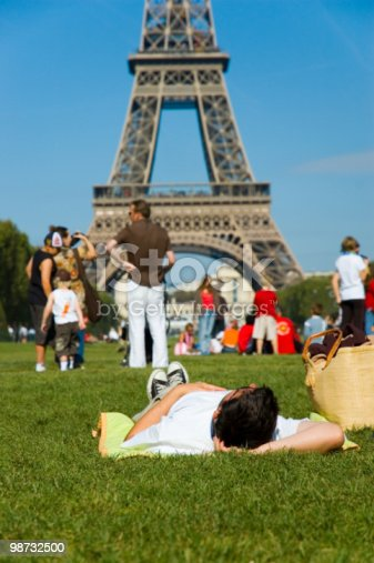 Man Laying On The Ground And Looking At Tour Eiffel Stock Photo & More Pictures of Adolescence