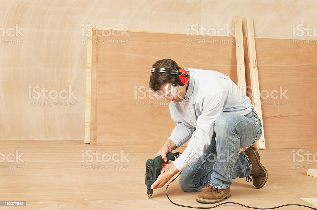Man laying plywood floor royalty-free stock photo