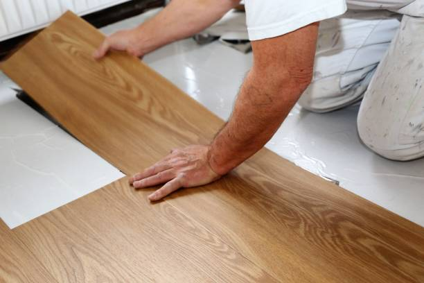 Man laying PVC-floor Man laying professional PVC-floor, close up pvc stock pictures, royalty-free photos & images