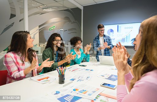 1007383644 istock photo Man leading a meeting at a board room and applauding someone for their monthly sales 875430108