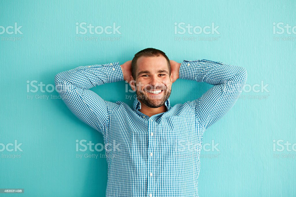 Man leaning against a wall stock photo