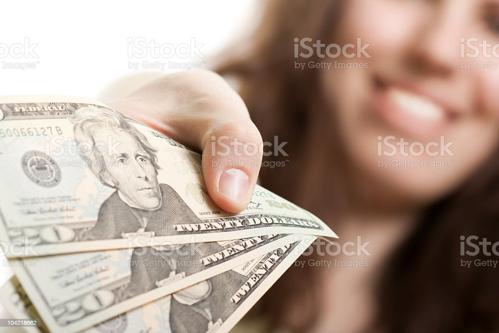 Man leaning his hand on brown patterned counter stock photo