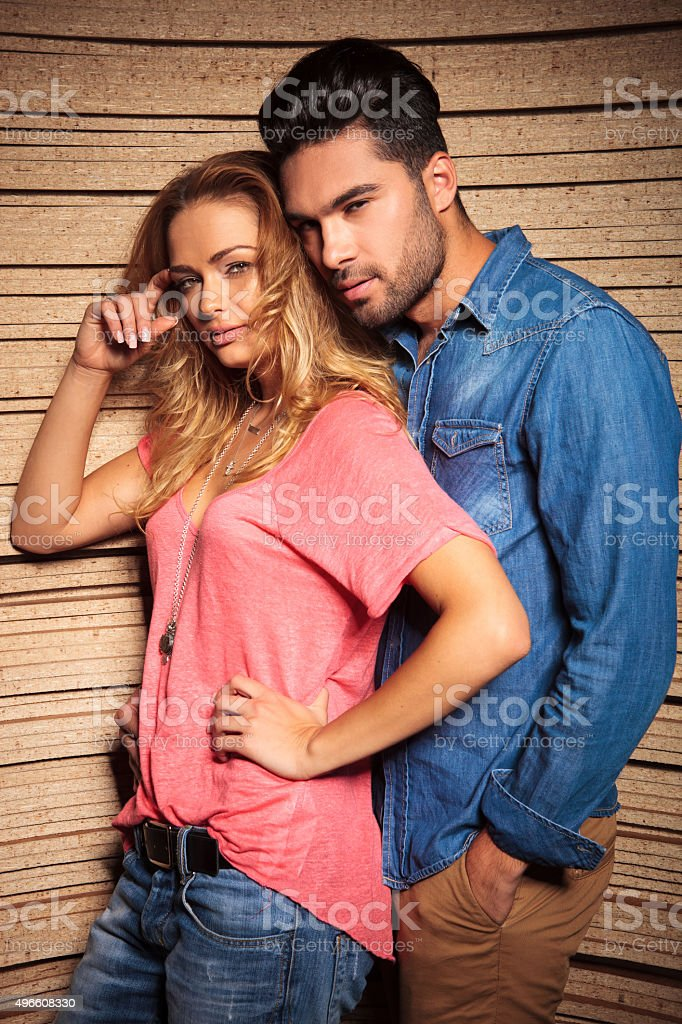 man leaning his head on his girlfrends shoulder stock photo