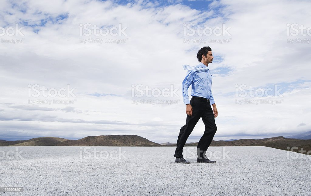 Man leaning into the wind royalty-free stock photo