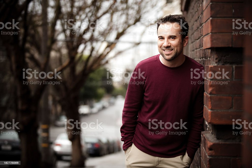 Man Leaning on a House in San Francisco royalty-free stock photo