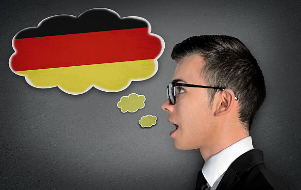 man learn speaking german - german culture stock pictures, royalty-free photos & images
