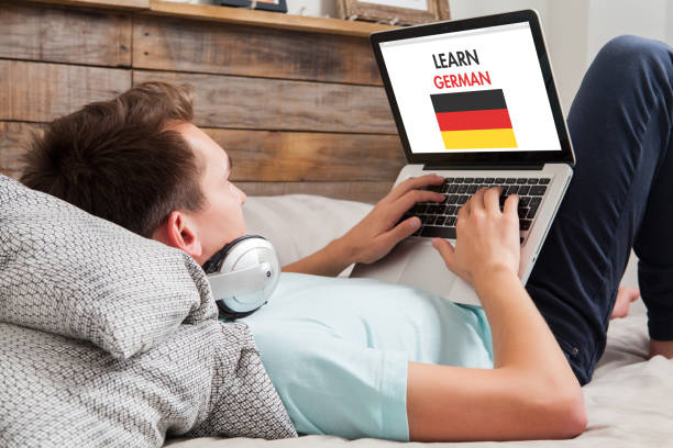 man learning german at home. - german culture stock pictures, royalty-free photos & images