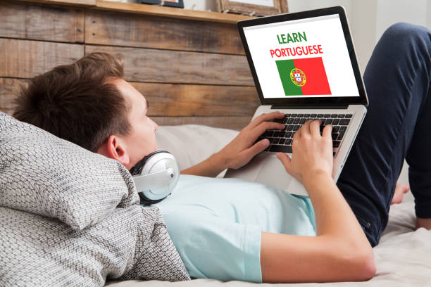 Man learning portuguese at home. stock photo
