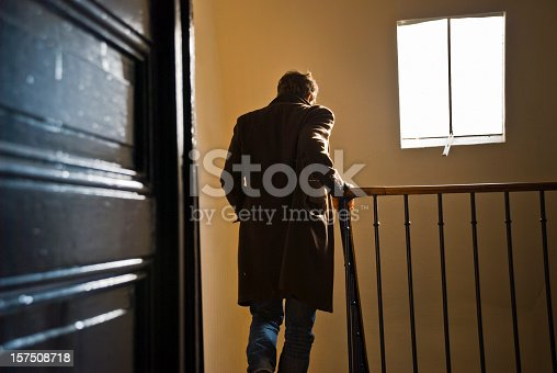 istock Man leaves home and goes downstairs  157508718