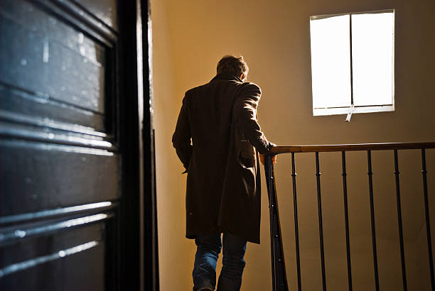 man leaves home and goes downstairs  - leaving stock photos and pictures