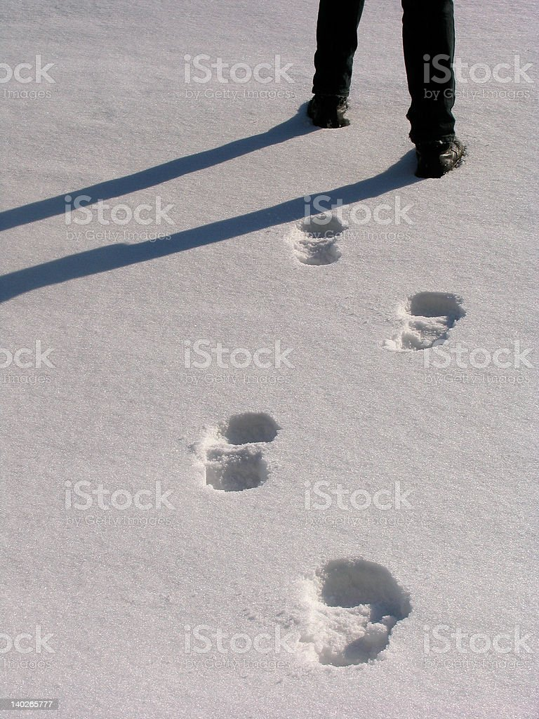 Man legs and footprints on the snow royalty-free stock photo