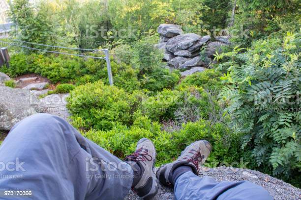 Photo of Man legs and shoes on vantage point Mandelstein, Austria